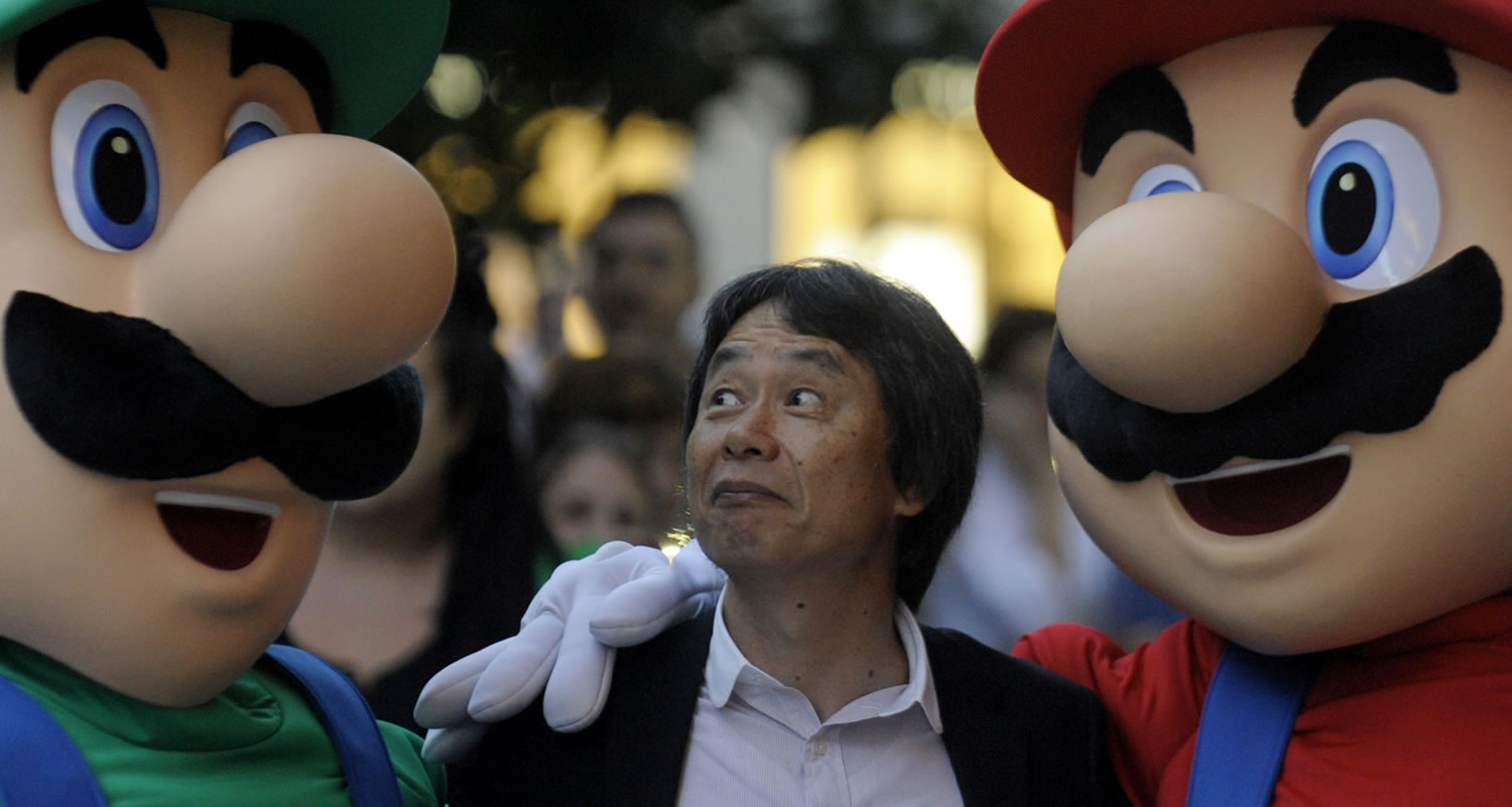 Shigeru Miyamoto with Mario and Luigi