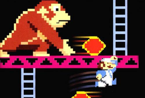 With malice in his pixelated eyes Donkey Kong hurls fireballs