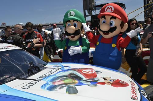 Mario and Luigi admiring the Mario Kart 8 themed NASCAR driven by Matt Kenseth