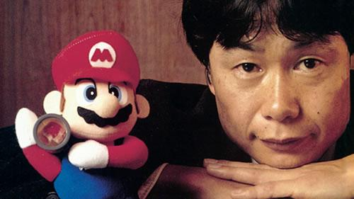 Shigeru Miyamoto with a Mario soft toy in 1995