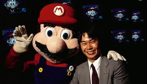 Shigeru Miyamoto with a very fat faced Super Mario
