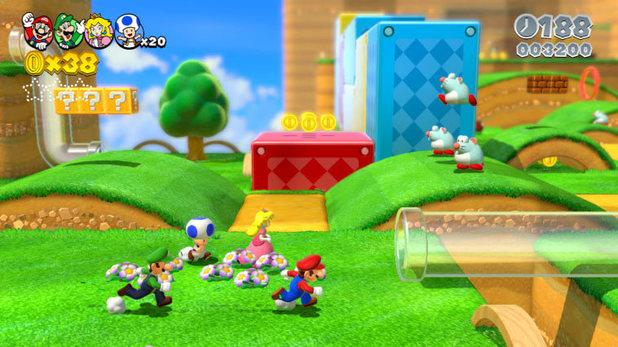 Mario, Luigi, Peach and Blue Toad heading towards a transparent pipe in Super Mario 3D World